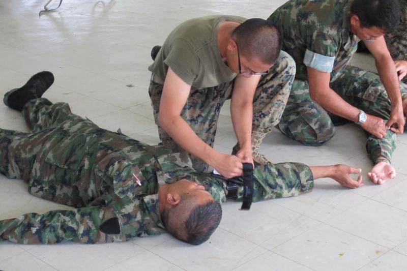 In this photo taken by Navy Petty Officer 1st Class Marlon Sammy/Released, Thai and U.S. Marines train using combat tourniquets.