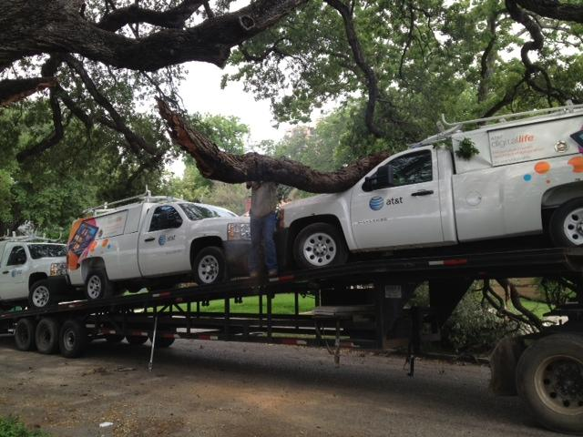 Trailer hauling AT&T trucks crashes into oak tree on Thorman Place in June