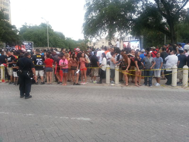 Police had to string yellow tape to control the thousands of people who showed up for the boxing promotion.