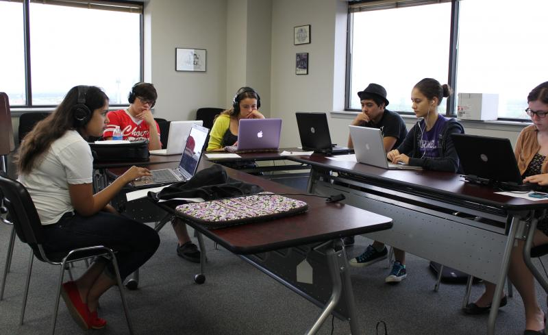 """Action shot"" of Camp KPAC students editing."