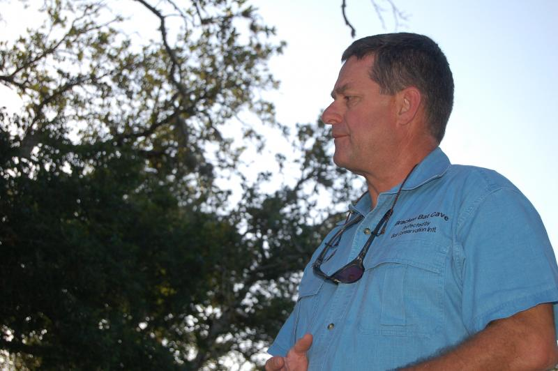 Cave coordinator Fran Hutchins prepares for the nightly flight of the bats.