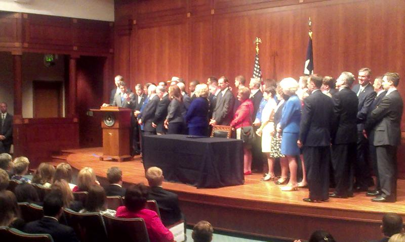 Rick Perry speaks before signing House Bill 2 into law.