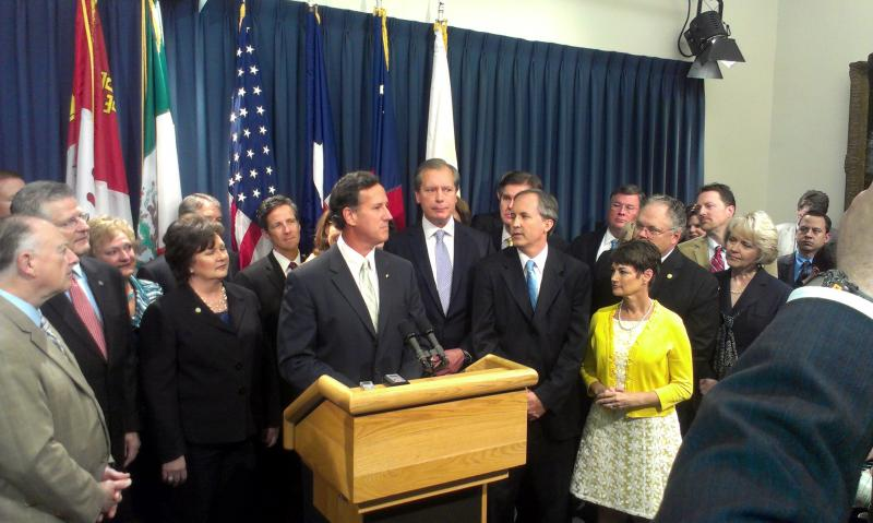 Rick Santorum takes the podium around Texas Republicans.