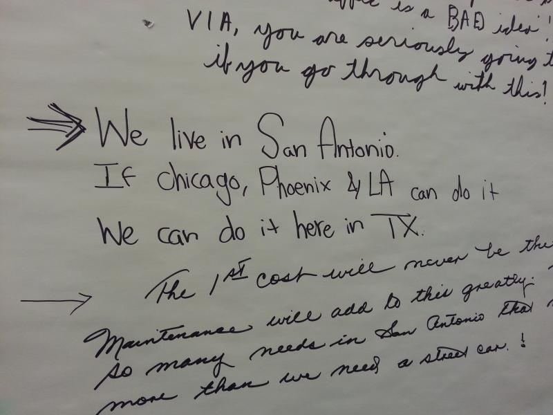 Citizens wrote down comments, both for and against, the streetcar project.