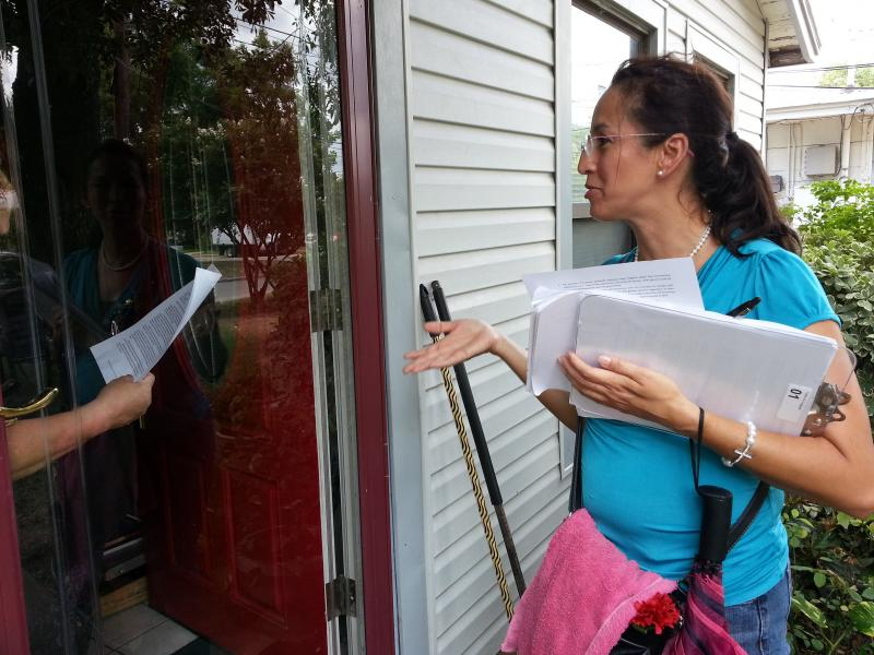 Cynthia Serna talks to a resident in District 1.