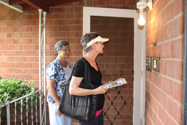 Volunteers with Enroll America's outreach campaign knock on doors in Phoenix.