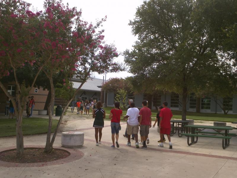 Students at Cole High School walk through campus.