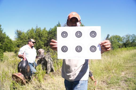 Rogaciano Macedo-Mondragon holds up his target sheet on Sept. 22 after taking aim with a pellet gun during the two-day hunter education course in Spanish of Texas Parks and Wildlife.