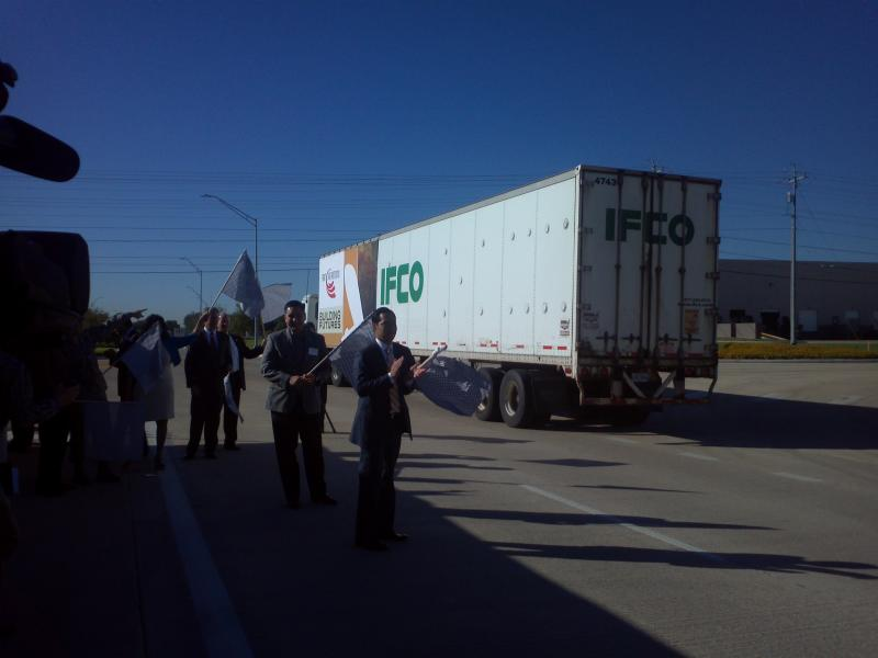 Local and state officials wave trucks through on the new section of 36th Street at Port San Antonio.