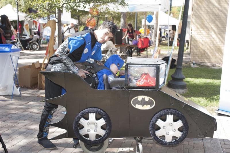 Batman patrolling Hemisfair Park grounds at AccessAbility Fest 2012.