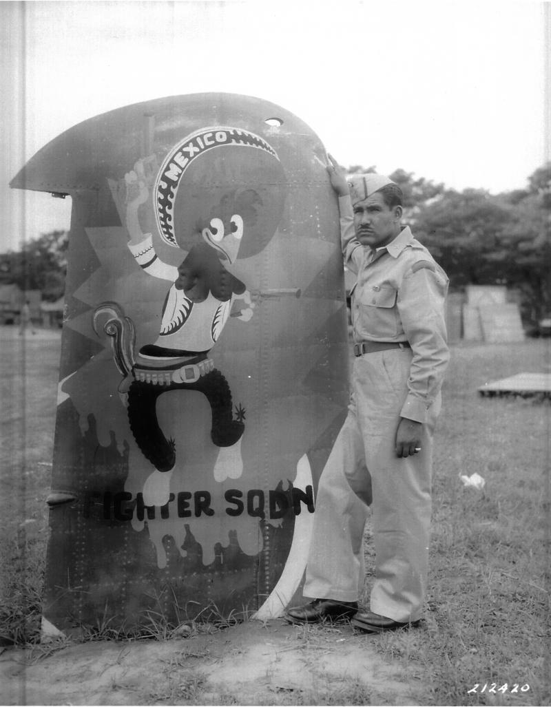 Corporal Manuel Alcantar Torres, next to mascot Pancho Pistolas