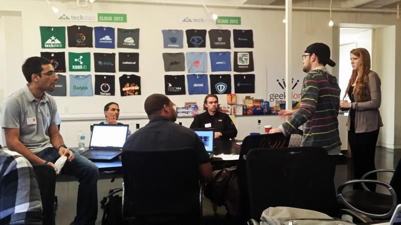 Rohit Saxena, left, works with his group at the start of 3DS San Antonio, or Three Day Start-up.