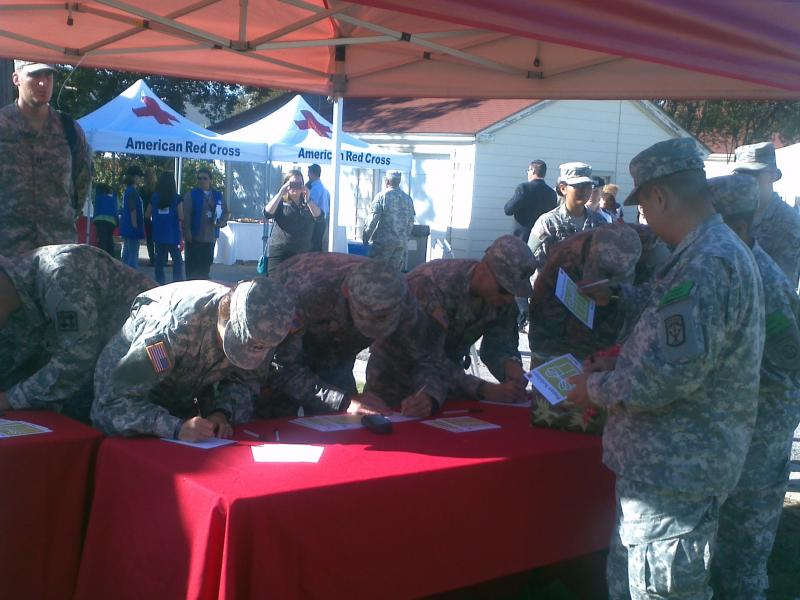 Maj. Gen. Jimmie Keenan joins fellow officers in signing holiday cards for the troops overseas