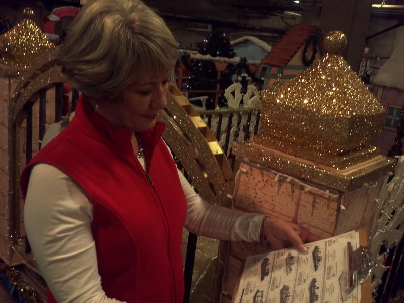 Nancy Hunt, Exec. Director of Paseo del Rio Assn., checking her list twice of all 26 floats