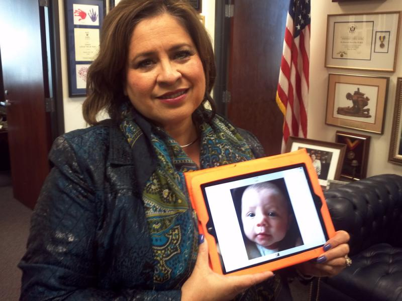 Leticia Van De Putte holds a picture of her grandson Rex, who died unexpectedly from SIDS this year.