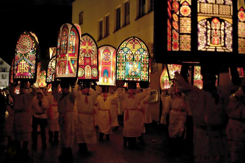 Klausjagen, 2011.  Men wearing Iffelen or Infuln, which are enormous, incredibly ornate paper / wood hats which resemble a cross between a bishop's mitre and a stained glass window.