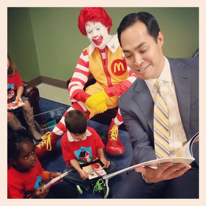 Mayor Julián Castro reads to children at the Northside model education center of Pre-K 4 SA following the announcement that McDonald's is donating 3,000 books to children in the program, and 7,000 overall to students in San Antonio.