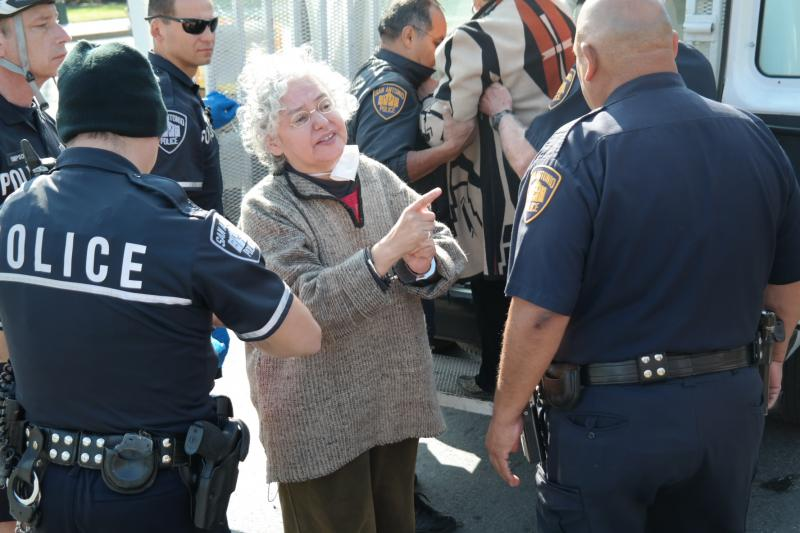 Graciela Sanchez of the Esperanza Peace and Justice Center gets arrested.