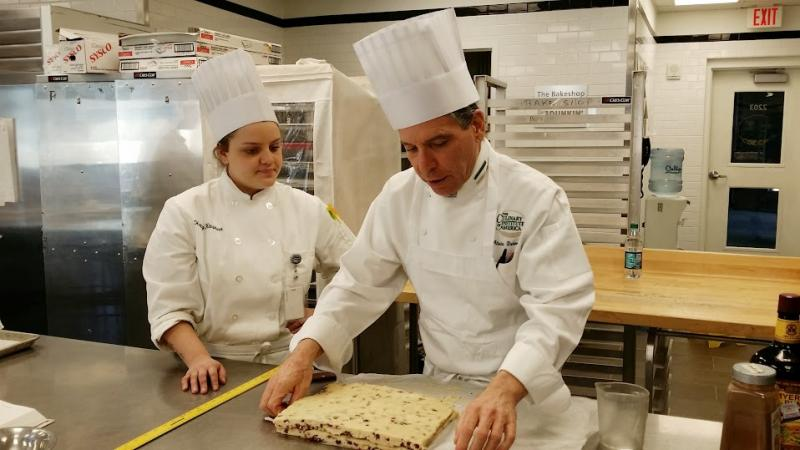 Alain Dubernard teaches his students in the school's only bake shop. The CIA's Bakery Cafe is closing to make room for more teaching space.