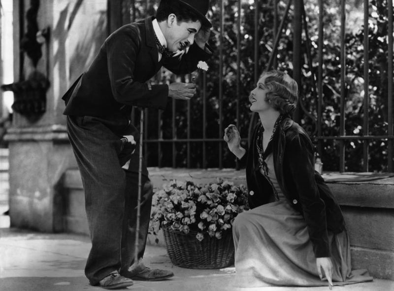 "The Tramp woos a blind flower girl in ""City Lights."""