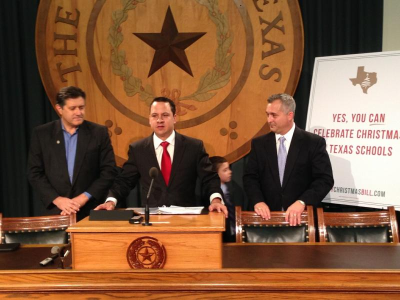 Jonathan Saenz with Texas Values speaks as Houston state Rep. Dwayne Bohac looks on (right).