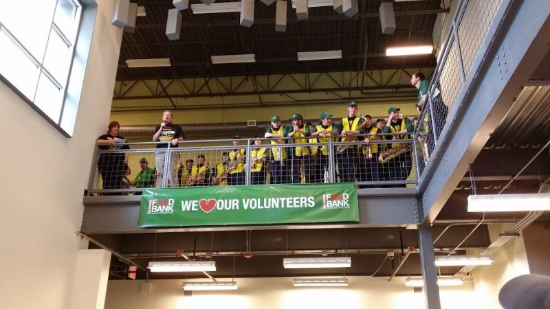 University of Oregon President Michael Gottfresdson told the crowd gathered at the San Antonio Food Bank that hunger is a big problem in America, and thanked participants from both institutions for giving their time to help the San Antonio community.