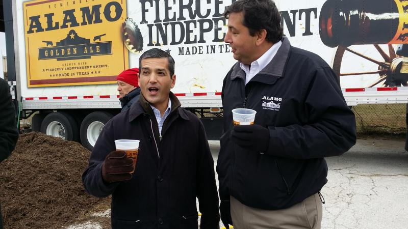 State Rep. Mike Villarreal, D-San Antonio (left) and Eugene Simor, founder of Alamo Brewing, drink the signature Alamo Golden Ale at the brewery's groundbreaking Friday.