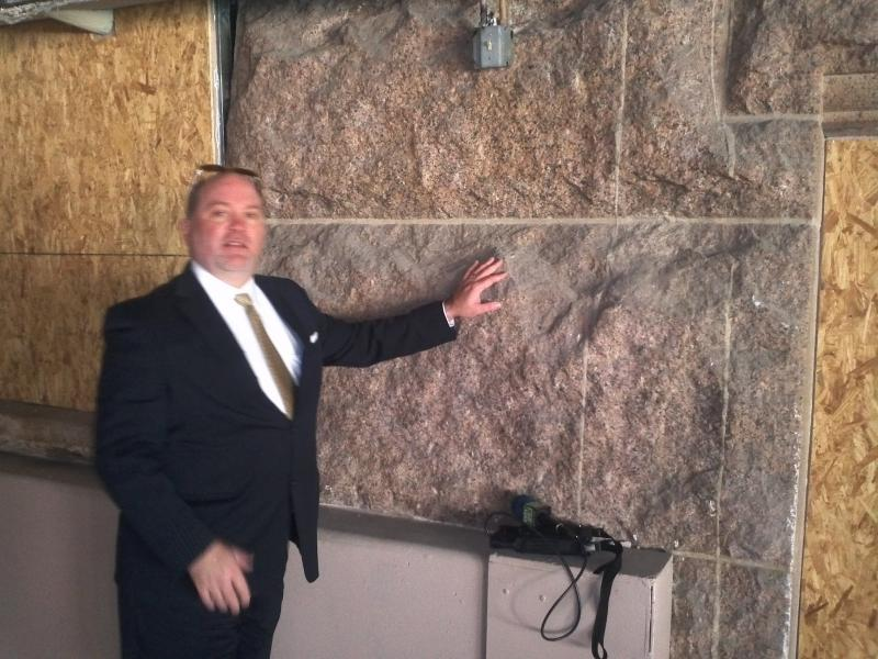 Bexar Co. Manager David Smith shows where the granite and stone of the oreiginal courthouse walls are visible, now that the basement under the Gondek addition has bee removed