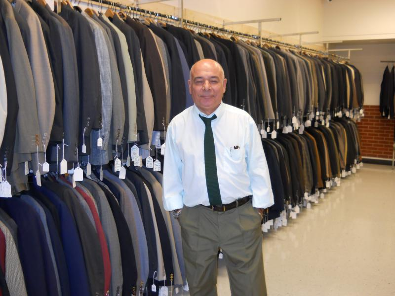 Job Placement Manager, Nelson Fernandini, in the men's suits area at Career Gear San Antonio