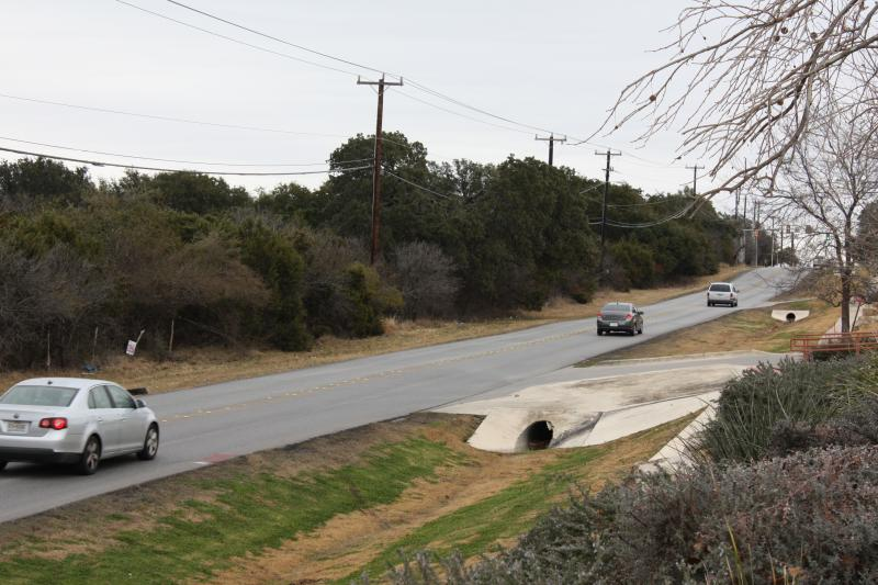 Two-lane Hausman Road, near its intersection with IH-10.