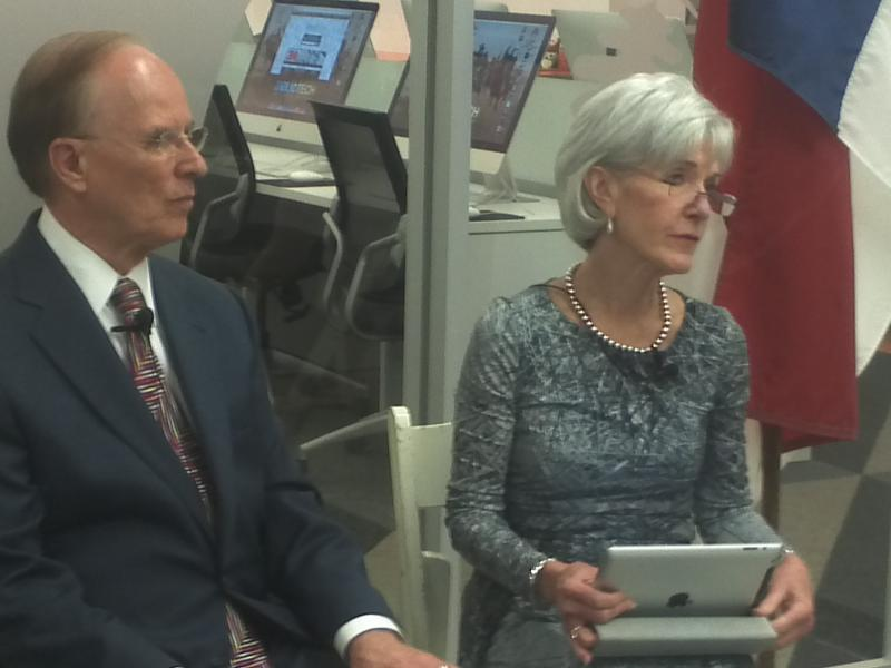 Bexar Co. Judge Nelson Wolff joins U.S. HHS Sec. Kathleen Sebelius at Bibliotech on her push to sign up more Texans for health care under the Affordable Care Act.