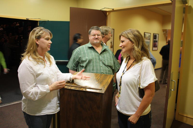 Marisa Wayne (right) visits with cinemagoers.