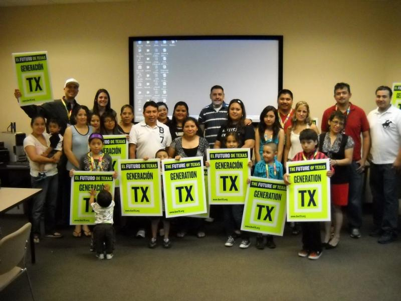 Janitors and children participating in Texas State University's Construyendo La Casa program