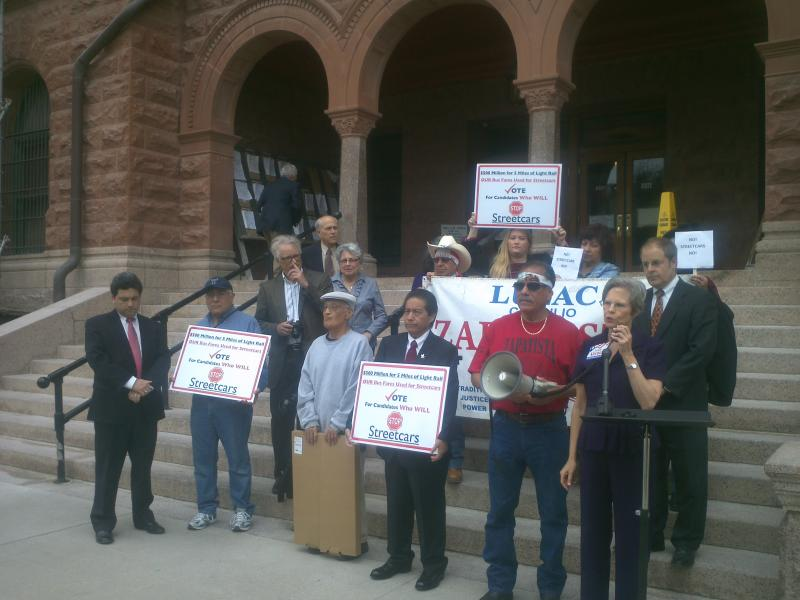 Protesters use the Bexar County Courthouse as a backdrop to speak out against the proposed downtown streetcar system.