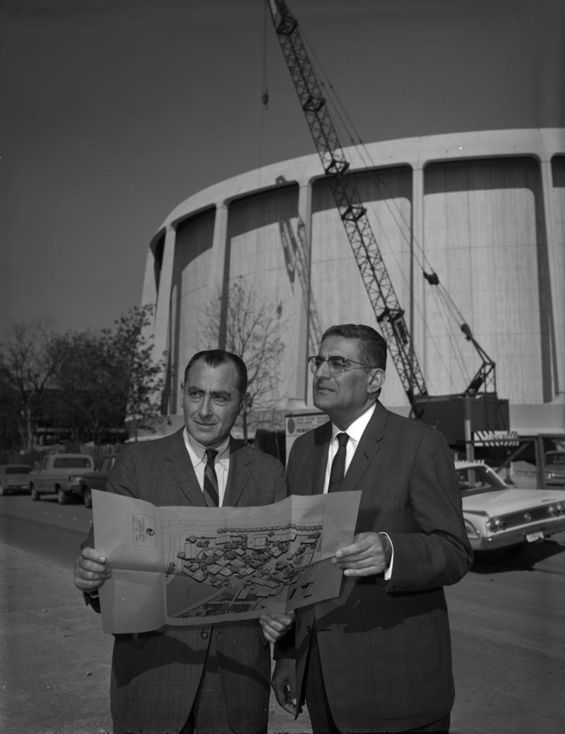 Bill Sinkin (left) oversees Hemisfair construction.