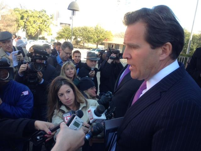 Attorney Neel Lane talks to reporters outside the San Antonio federal court building following the Feb. 12 hearing on the case.
