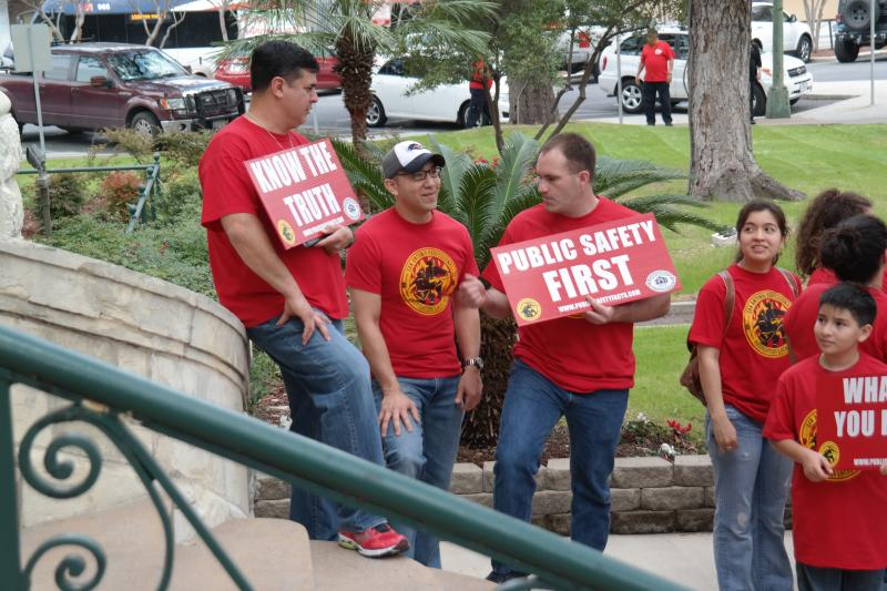 Members from the police and fire departments lined the plaza outside City Hall to let council members know how they feel about their benefits.