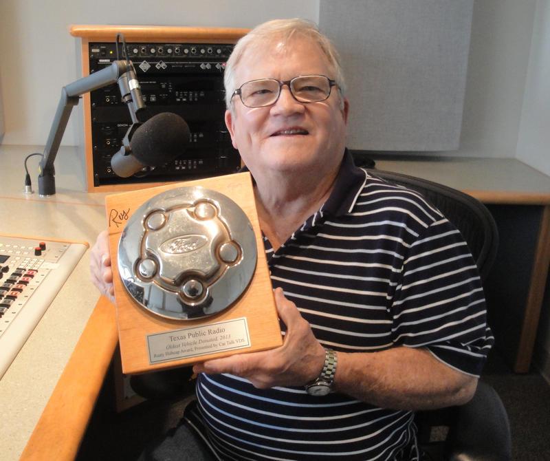 """Donald Braun, with the """"Rusty Hubcap"""" award."""