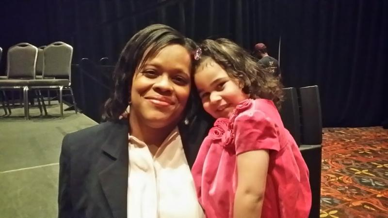 Tracy Mayon and her daughter, Haylee, pose together after the annual State of the City address. Mayor Julian Castro invited the mother/daughter to be his guests because Haylee attends Pre-K 4 SA in its inaugural year.