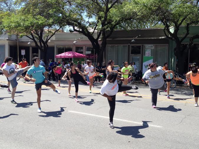 Several people particiate in a Reclovía, or recreation station, at St. Mary's at Cesar Chavez Street during the sixth Síclovía.
