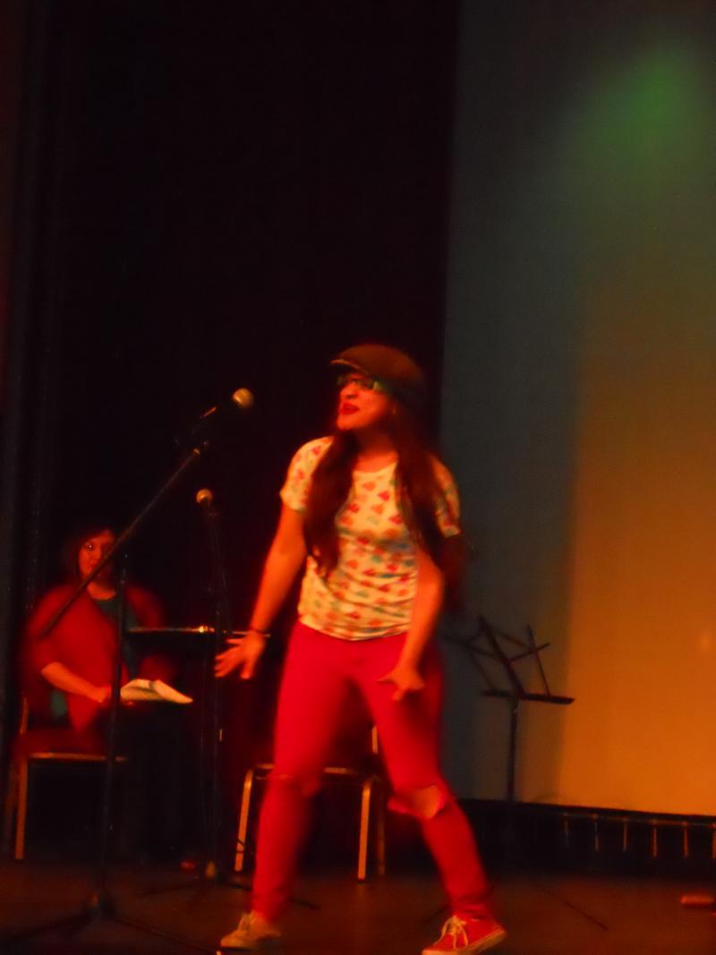 """Amanda Flores, performing her poem, """"Manu Ginobili"""" at Saturday's performance of San Antonio: Mi Pueblo at the Guadalupe Theater."""