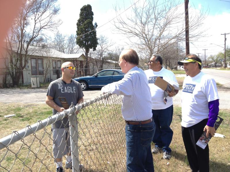 Nelson Wolff speaks to a Southside resident during his blockwalking campaign.