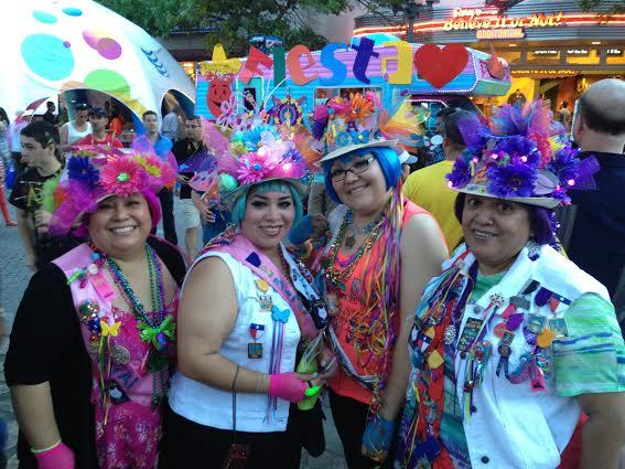 (Left to right) Mary-Jane Torres, Veronica Kieff,  Erica Torres, and Helen Figueroa show off their elaborate hats, a Fiesta tradition, at Fiesta Fiesta.