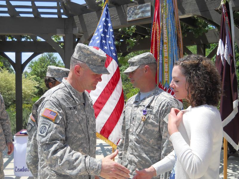 Lt. Gen. Perry Wiggins greets Staff Sgt. Robert Drebenstedt and his family.