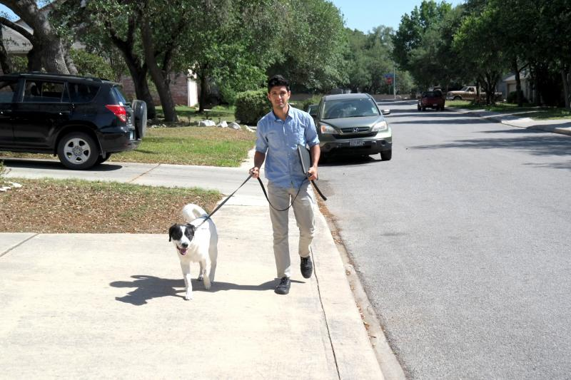 In the final week and a half of campainging, Corey Clark walks in a neighborhood with his dog, Jimmy, to meet voters.