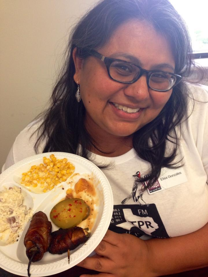 Volunteer and Events Coordinator Elisa Gonzales showcases one of the meals provided to staff and volunteers