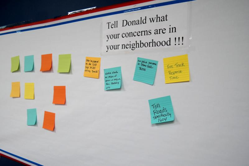 A message board inside Oroian's North Side business displays Post-It notes from constituents on what they'd like to see improved or worked on.