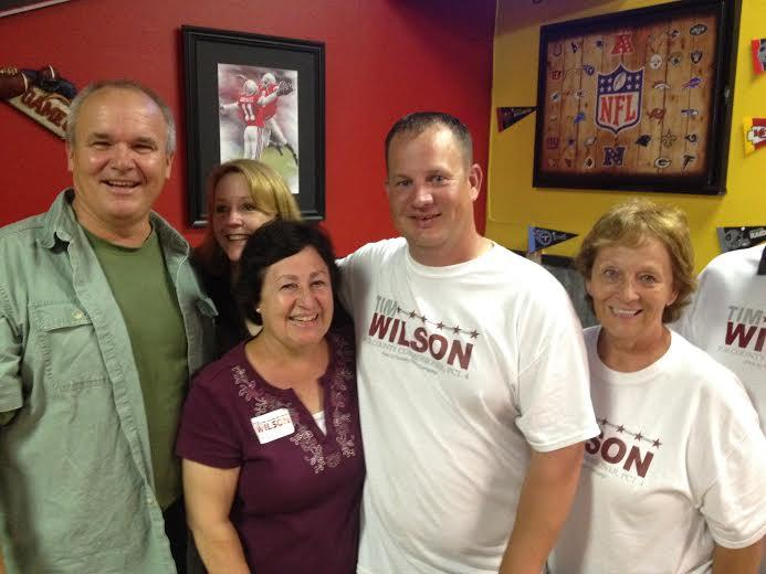 Kirby Mayor Tim Wilson (second from right) stands with family members after the final votes were reported.