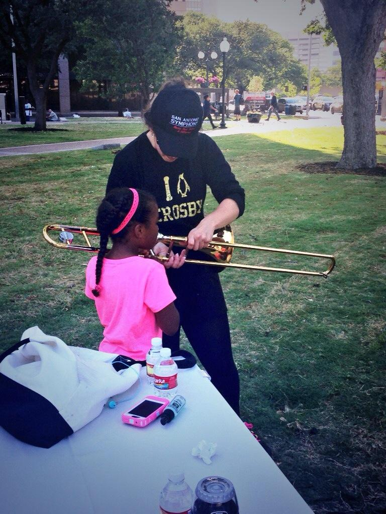 An instrument petting zoo at Travis Park allowed kids to try out various horns.