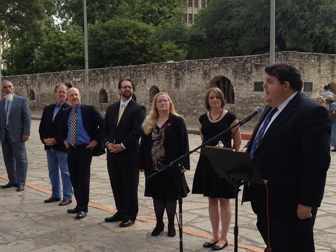 Robert Butler, candidate for lieutenant governor, addresses his libertarian colleagues and audience members infront of the Alamo.